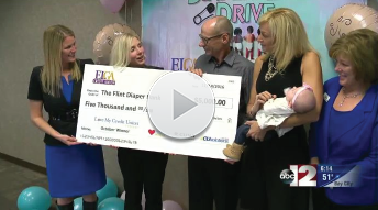 Flint Diaper Drive Gets Huge Check from Love My Credit Union Rewards